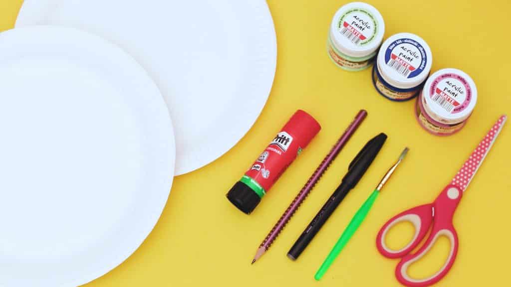 Image showing two paper plates, paint, paint brush, glue stick, scissors and pencil.