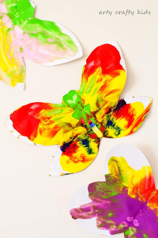 Arty Crafty Kids   Art   Easy Butterfly Kids Art   A butterfly twist on a classic process art project for kids. Sweet and simple for toddlers and preschoolers, a perfect Spring Craft for Kids!