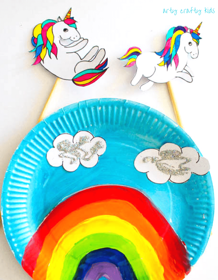 Arty Crafty Kid | Craft | Over the Rainbow Paper Plate Unicorn Puppets | Using the free Unicorn download, cut and colour to create playful puppets, who love to jump, slide and dance over the cute paper plate rainbow! A fun interactive craft and play craft idea for kids!