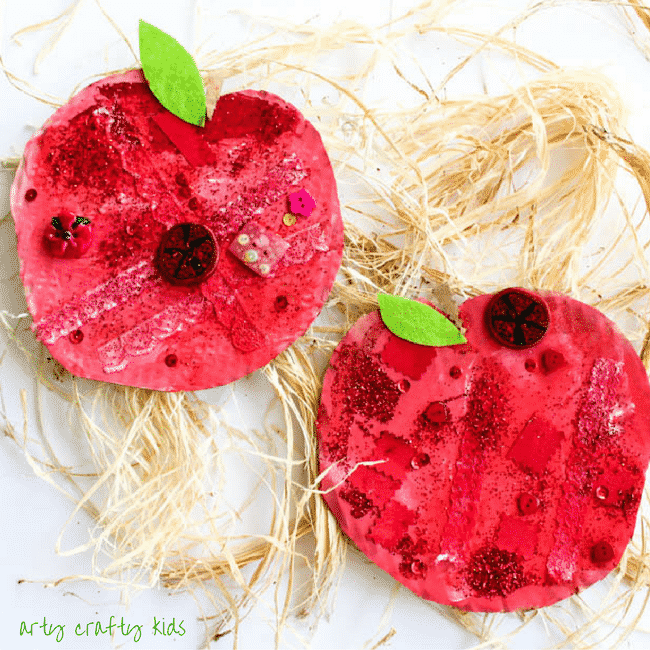 Arty Crafty Kids | Craft Ideas for Kids | Autumn Crafts | Easy Apple Collage Craft | A fun back to school and Autumn Apple Craft for Kids, using loose parts within the theme of 'Red' to create an apple.