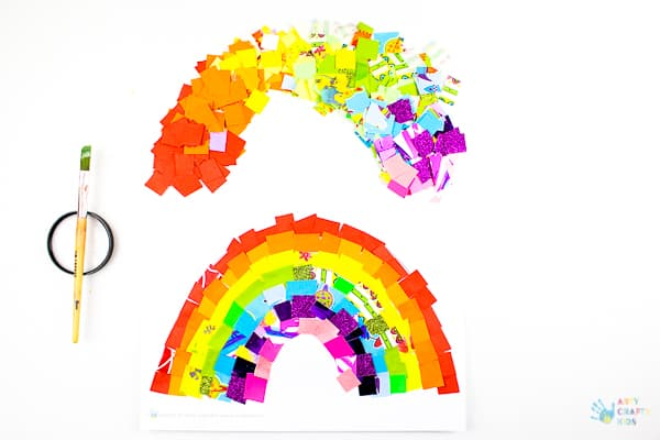 Arty Crafty Kids | Art Ideas for Kids | Rainbow Paper Collage | A fabulous rainbow paper collage activity that promotes cutting skills & colour play within a free rainbow template for kids to follow #rainbowart #preschoolart #craftsforpreschoolers #kidscrafts #scissorskills