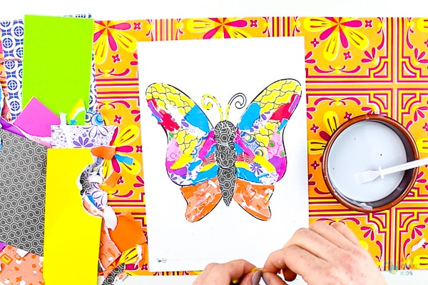 Arty Crafty Kids | Art | Butterly Paper Collage - A simple activity using torn scrap paper to create a colourful, textured butterfly. A wonderful craft for kids! #artycraftykids #recycledcraft #easykidscraft #craftsforkids #kidsart #artideasforkids #easykidsactivities