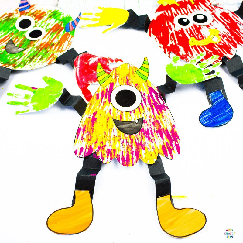Arty Crafty Kids | Big Hand Paper Monster Craft - Add your Arty Crafty Kids handprint to create a moving grooving Big Hand Monster! A fun and playful monster craft for Halloween, with a choice of 4 monster templates.
