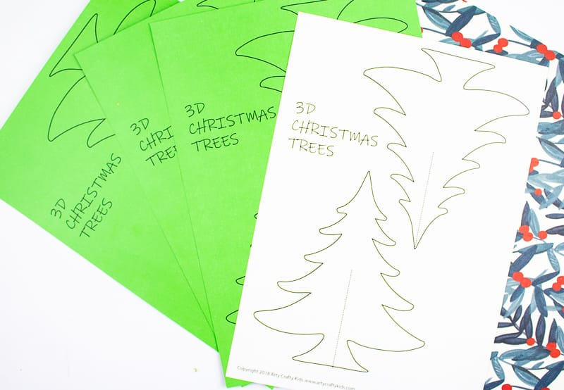 Arty Crafty Kids   3D Printable Christmas Tree Craft - A fun paper Christmas tree craft for kids. Download, print and decorate with tissue paper, buttons and fingerprints! #printable #christmascraft #kidscrafts #christmas #papercraft #kids