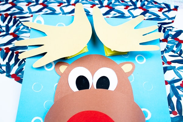 Arty Crafty Kids | 3D Printable Rudolph Craft for Kids. Play with shapes and dimension to create a cool 3D Reindeer with bouncy handprint antler! A fun and engaging Christmas craft for kids #christmas #printable #papercraft #christmascrafts #kids #kidscrafts