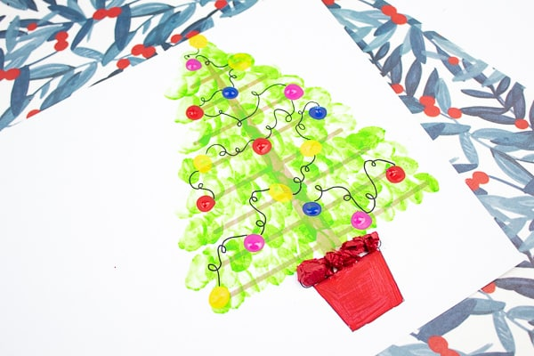 Arty Crafty Kids | Fingerprint Christmas Tree Card - Using the template as a card, kids can add a personal touch to their Christmas Cards by adding their fingerprints to form a Christmas Tree. A simple, beautiful Christmas card idea that kids will love creating #christmascrafts #christmas #papercrafts #kidscrafts #template #printables