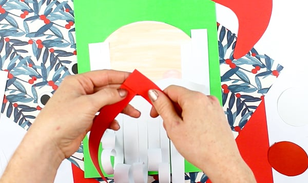 Arty Crafty Kids | Printable Paper Santa Craft - An engaging and fun Paper Santa Craft for kids. With his bouncy nose and curly beard, it's a Christmas craft that promotes scissor skills and fine motor development #christmas #christmascraft #printable #kidscraft #template