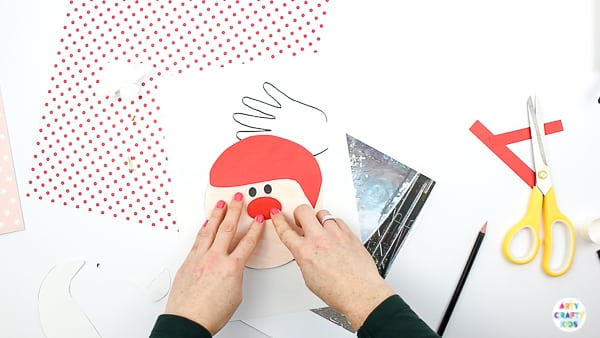 Arty Crafty Kids | Santa Handprint Craft - A printable Santa Christmas Card craft for kids! simply unfold the handprint beard to reveal your Arty Crafty Kid wishing loved ones a Merry Christmas #printable #christmascraft #kidscraft