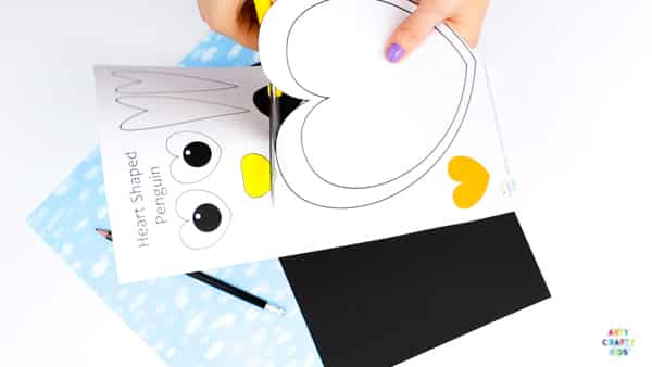 Arty Crafty Kids | Super cute and easy Printable Penguin Heart Craft for kids. A great craft that fits into both valentine's day and winter themed crafts. Simply download and print the template to get started! #kidscraft #templates #printables #easycrafts #papercrafts #teachers