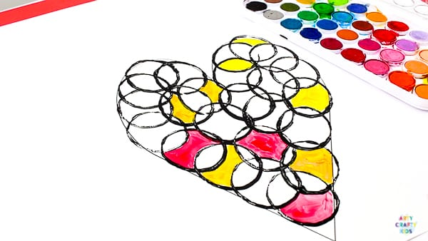 Arty Crafty Kids   A Valentine's themed Circle Heart Art Project for kids. Simply download the printable template to get started! #artycraftykids #valentinesday #kidsart #kidscrafts #templates #printable