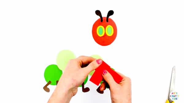 Arty Crafty Kids | The Very Hungry Caterpillar Printable Craft for kids to make. Perfect for covering bug and butterfly life-cycle topics. Download the Caterpillar Template to get started @artycraftykids