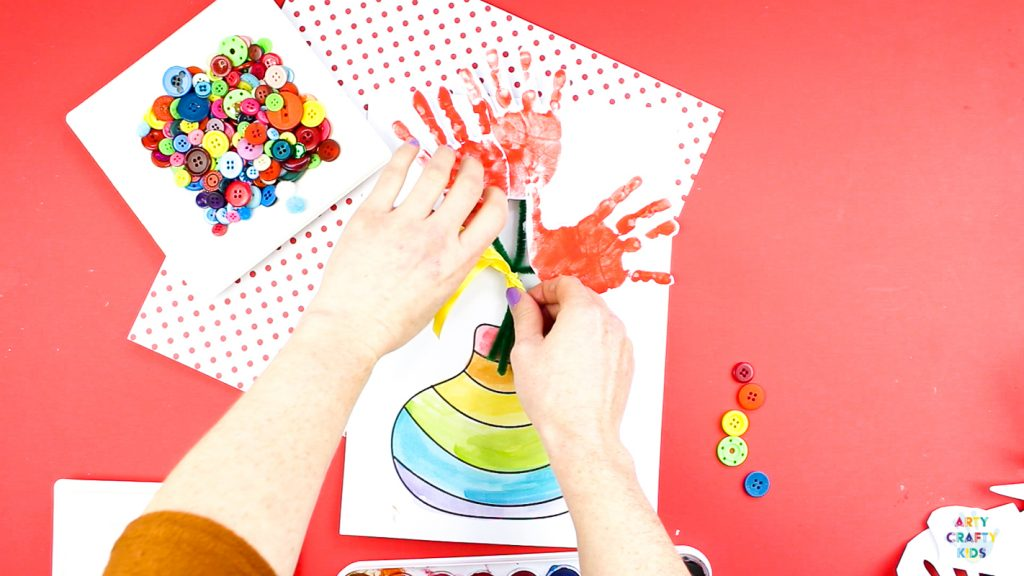 Mother's Day Handprint Flower Craft for kids to make. Simply download the printable template to get started. @artycraftykids