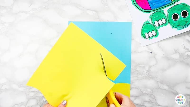 Create a paper beach scene of the 3D Paper Turtle Craft.