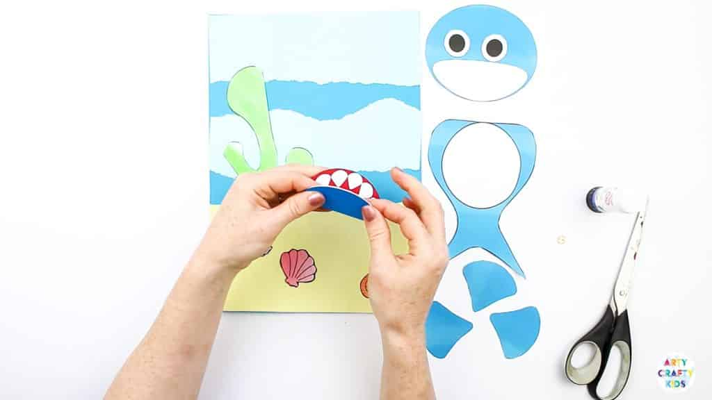 An easy Swimming Baby Shark Craft for kids to make. A great printable shark craft for  Summer and shark week. #artycraftykids #sharkweek #craftsforkids