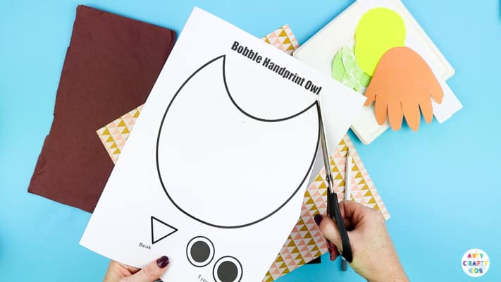 Print and cut out the Bobble Handprint Owl Printable Template.