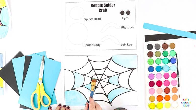 Paint the printable Halloween spider web.