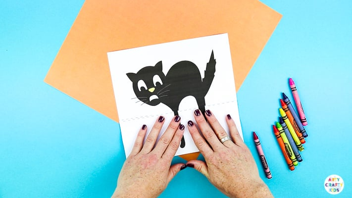 Arty Crafty Kids | Surprise Black Cat Printable Craft  - A fun Halloween craft for kids. Unfold the paper toy to reveal and an eight legged surprise!