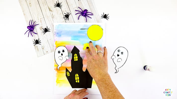 Arty Crafty Kids | Easy Bobble Ghost Halloween Craft for Kids. These playful ghosts will bounce and bobble above their haunted house, creating a fun and engaging paper craft kids will love!