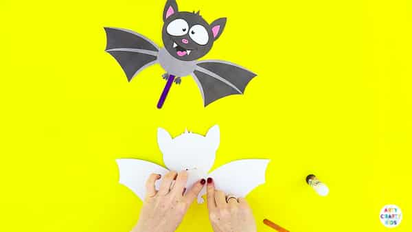 Halloween Crafts for Kids | Glue the wings to the paper toy bat.