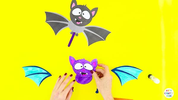 Halloween Crafts for Kids | Assemble the body of the bat paper toy.