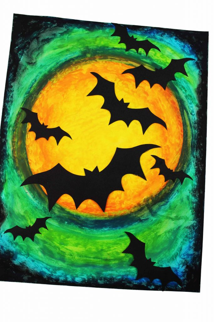 Arty Crafty Kids | Oil Pastel Bat Silhouette Art for Kids - an easy Halloween art project for kids.