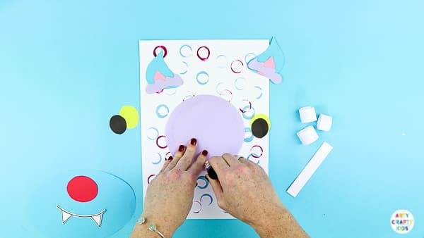 Arty Crafty Kids | Secure the wolf elements to the backdrop.