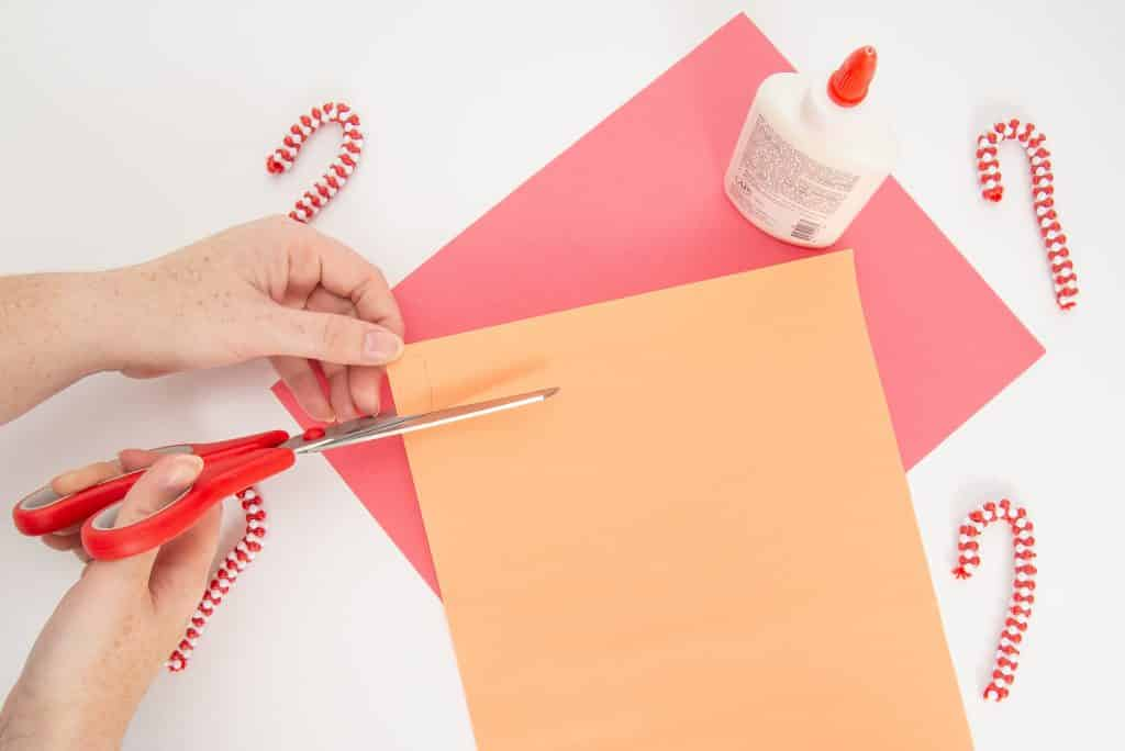 Use orange construction paper to create a nose for the paper roll snowman.