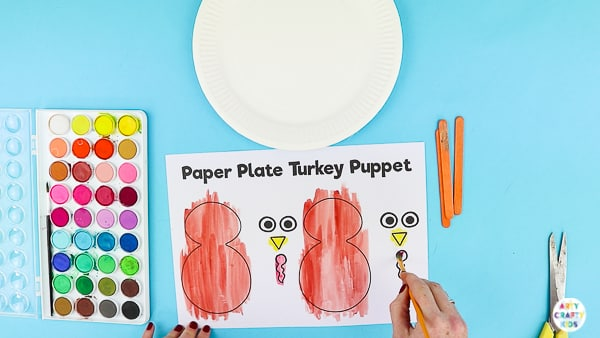 Arty Crafty Kids | Using a printable turkey template to create a turkey puppet.