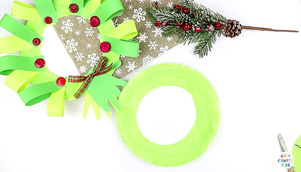 Arty Crafty Kids | Easy Paper Plate Handprint Christmas Wreath for Kids to make.