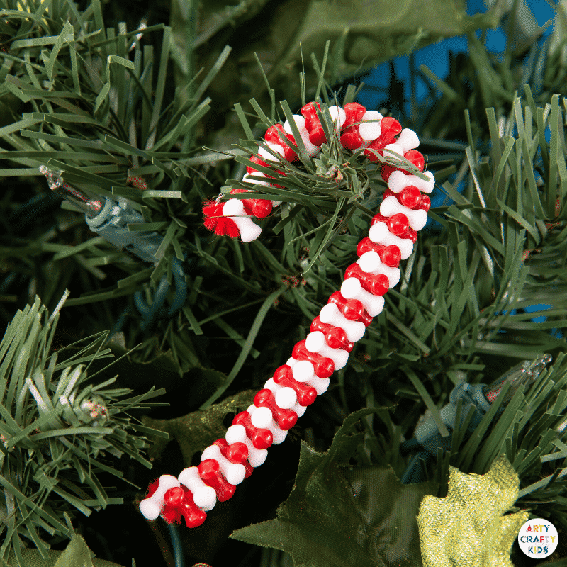 Make Beaded Candy Cane Ornaments with the kids this Christmas. Made with just two materials, kids will love this simple and fun Christmas craft.