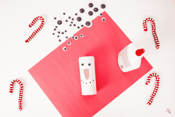 Add a face to the paper roll  snowman.
