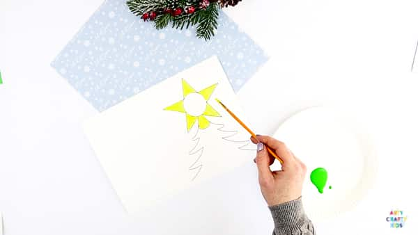 Photo Christmas Tree Card for kids to make | A fun and easy Christmas craft for kids with a personal touch. Add a photo and fingerprints to create a special Christmas keepsake.