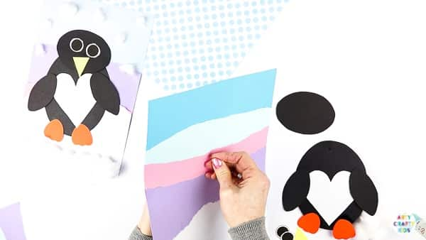 Interactive Paper Penguin Craft - Inspired by Happy Feet. A fun and engaging Winter craft for Kids. With a penguin that moves and dances on the snowy floor, this is a craft that inspires children to play!