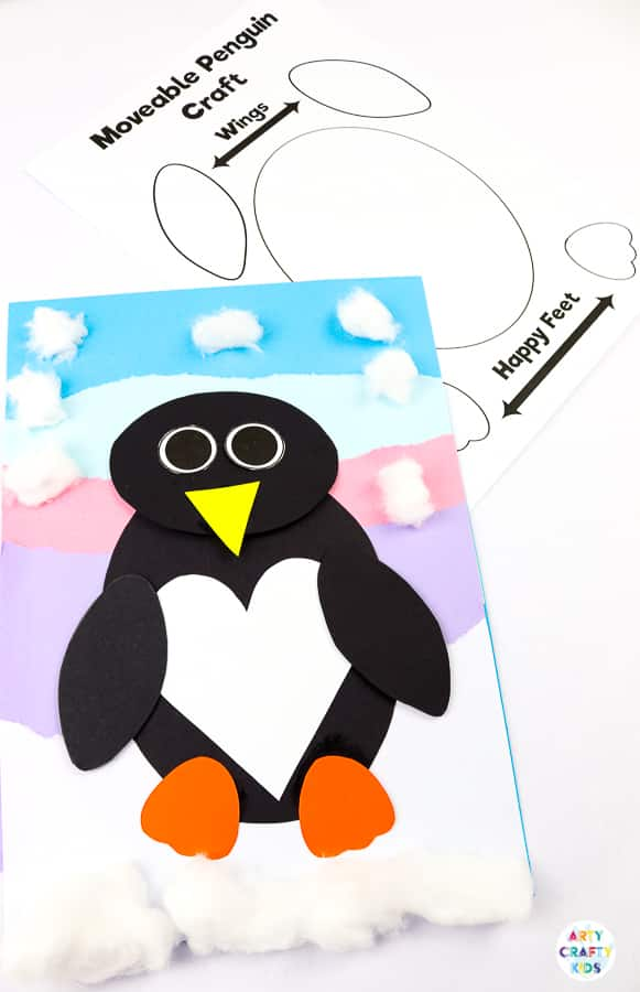 Interactive Paper Penguin Craft - Inspired by Happy Feet. A fun and engaging Winter craft for Kids. With a penguin that moves and dances on the snowy floor, this is a craft that inspires children to play! This craft can be completed with our Printable Penguin Template.