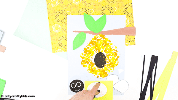 Bobble Bee Paper Craft for Kids | An engaging, fun and easy Spring Craft that kids will love! Use our printable templates to create a bee that buzzes and bounces around its beehive.