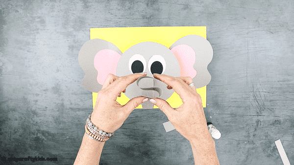 3D Paper Elephant Craft: Fold the nose into an S shape.