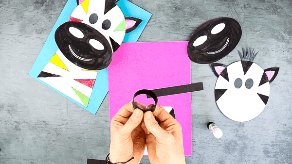 Create two paper card loops.
