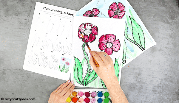 Fill the poppy design with watercolour paint.