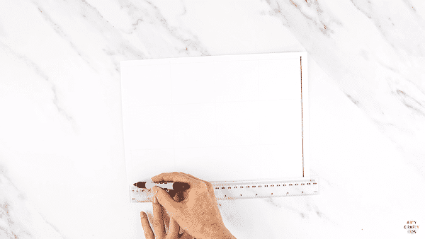 DIY Stamp Art for Kids: Measure out the a4 paper to create a grid.