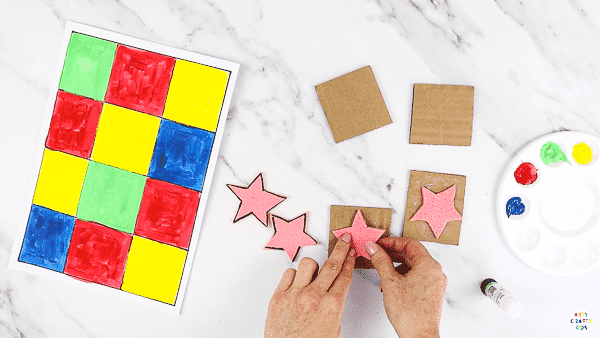 Cut out the sponge shapes and glue to the cardboard squares.
