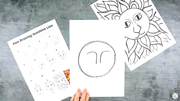 Start by drawing a big circle in the middle of the cardstock.   Draw a pair of eyebrows that almost meet in the middle and form to make a bridge of a nose.