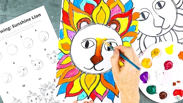 Let's begin painting the lion. Fill the mane with bright fiery colours - red, yellow, orange.