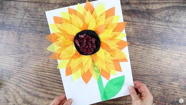 The Easy Tissue Paper Sunflower Craft is Complete!   Looking for a fun Summer craft to try with your children? check out this glorious and easy sunflower craft for kids!