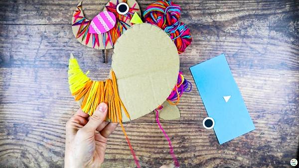 Wrap the yarn around the cardboard bird.