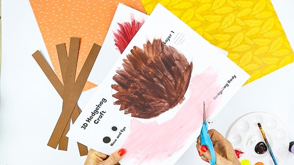 Paint the template for the 3D Paper Hedgehog Craft.   Once dry, carefully cut out the hedgehog elements.