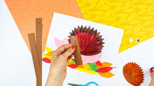 Create paper loops from brown paper cardstock.