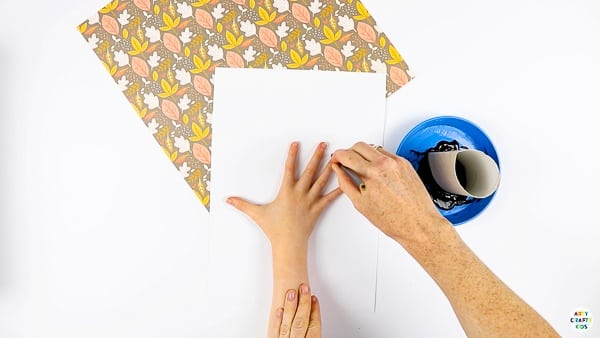 Trace the hand and arm to create a handprint tree.