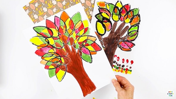 Paper Roll Printed Autumn Handprint Tree - A fun and easy Autumn art project for kids that explores color and shape while adding the personal touch of a handprint.