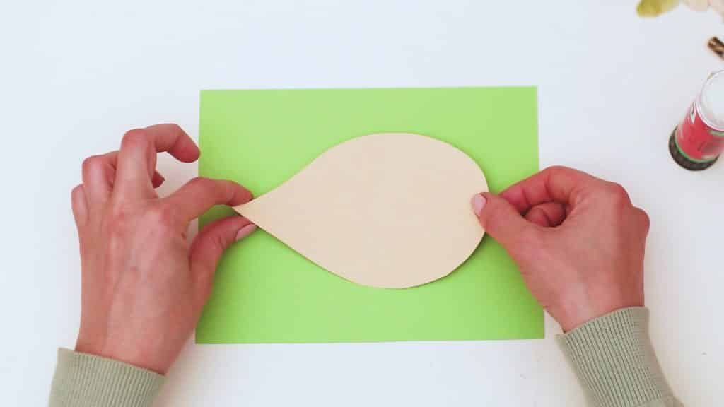 Secure the shape to a piece of green backing card.