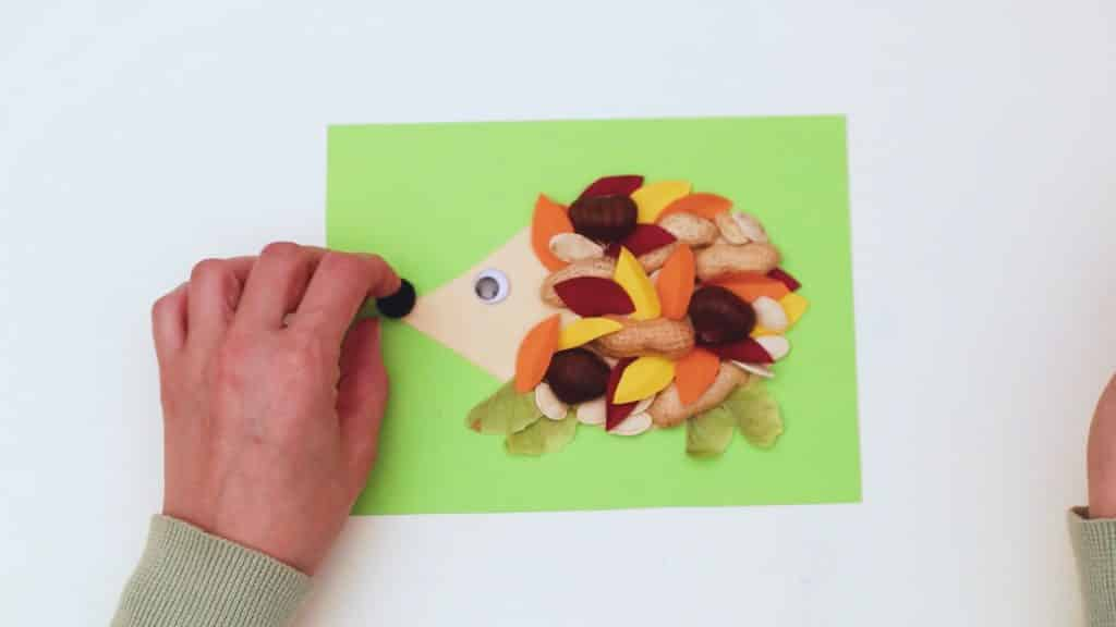 Complete the Nature Hedgehog Craft with an eye and pom-pom nose.